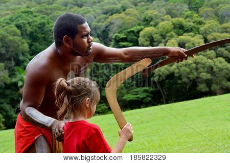 Aboriginal Australians Man Teaches A Young Girl How To Throw A Boomerang
