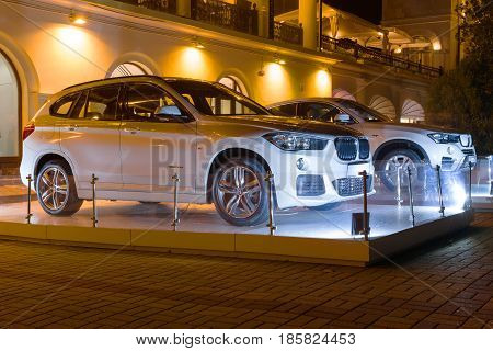Sochi, Russia - October 12, 2016: New Luxury Bmw x4 and x6 at night new model of the brand BMW near the dealers showroom.