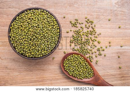 Mung Beans In Wooden Bowl Put On Wooden Plank Background