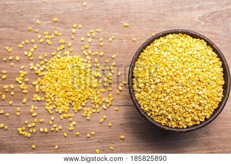 Peeled Mung Beans In Wooden Bowl Put On Wooden Plank Background