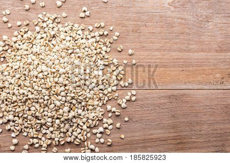 Millet Rice Or Millet Grains On Wooden Table Background