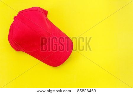 New Blank Red Baseball Hat On Yellow Background With Free Space For Design