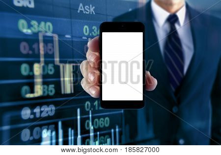 Man showing smartphone with stock chart background
