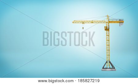 A yellow stationary tower crane without any load in full length on blue background. Building and construction. Workplace machinery. Heavy loads.