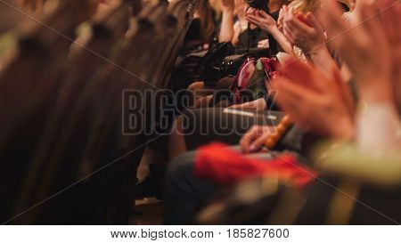 Theater hall - spectators is applauding the performance on stage, telephoto