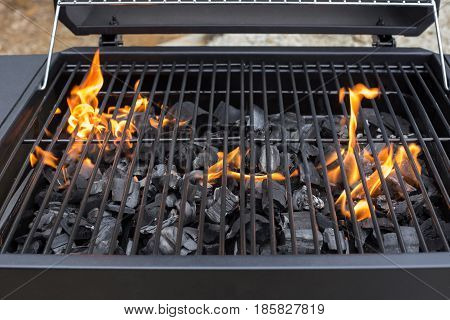 Grill, BBQ, fire, charcoal barbecue, closeup. Roaster grate for cooking outdoor