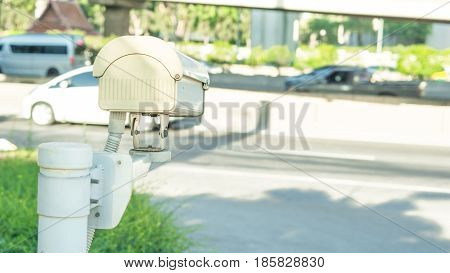 Security equipment concept - CCTV camera surveillance on car parking Safety system area control and copy space