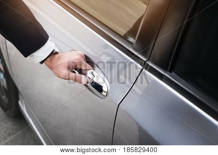 Chauffeur S Hand On Handle. Close-up Of Man In Formal Wear Opening A Passenger Car Door