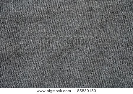 Closeup surface fabric pattern at the old black fabric trousers textured background
