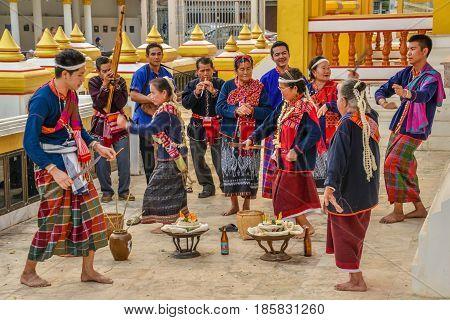 NAKORN PHANOM THAILAND - FEBRUARY 14, 2015 : Thai northeastern Phutai people show ancient rite of worship to household spirit in Phutai world event day in Renunakorn of Nakorn Phanom, Thailand.