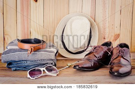 Travel accessories. Shirts jeans hatsshoesbag Beltsunglasses ready for the trip
