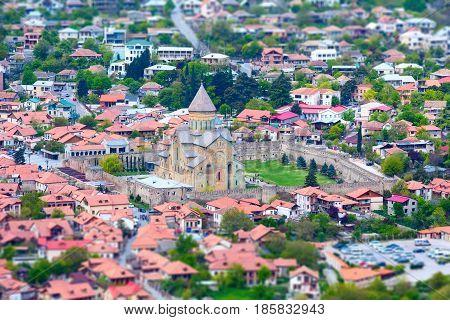 Tilt shift panoramic aerial view of Mtskheta, Georgia with Svetitskhoveli Cathedral