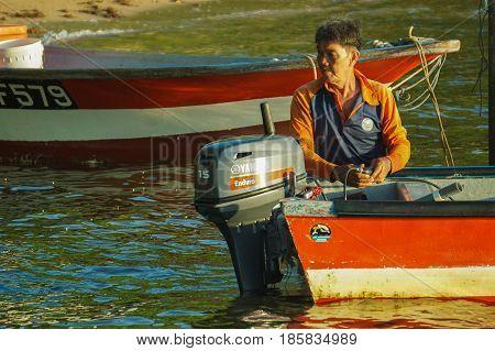 Labuan,Malaysia-May 10,2017:Traditional fisherman with fishing boat ready to fishing in the morning at Tanjung Aru village,Labuan island,Malaysia.