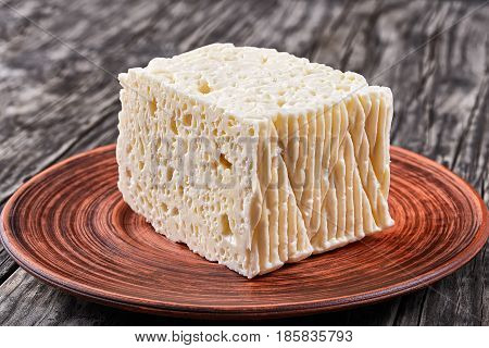 Piece Of Feta Cheese On Plate