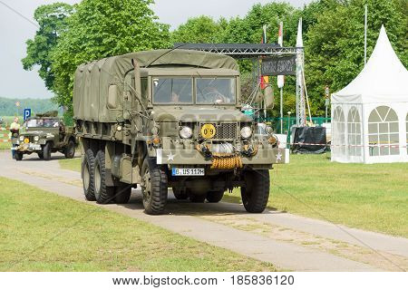 PAAREN IM GLIEN GERMANY - MAY 19: American middle truck U.S. Army M35 The oldtimer show in MAFZ May 19 2013 in Paaren im Glien Germany