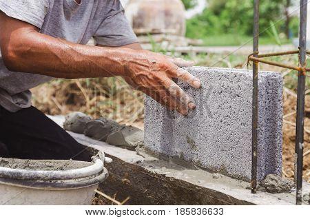 inbricklayer installing bricks and Masonry work in construction