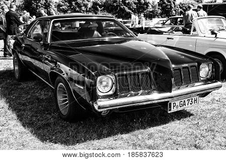 PAAREN IM GLIEN GERMANY - MAY 19: Mid-size car Pontiac Grand Am (black and white) The oldtimer show in MAFZ May 19 2013 in Paaren im Glien Germany