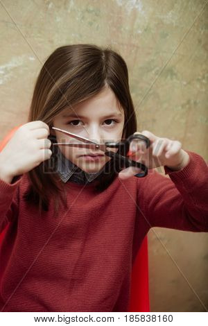 Hairdressing And Hairstyle, Cute Girl Cutting Hair With Scissors