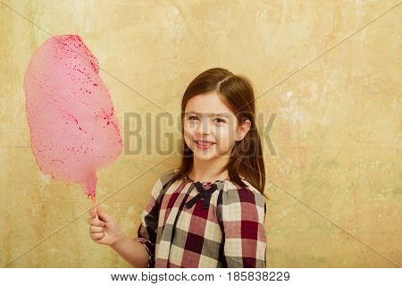 Happy Pretty Girl Smiling With Cotton Candy On Stick
