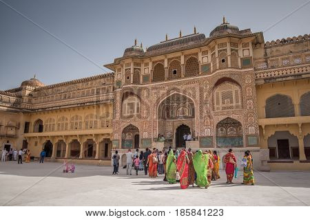 JAIPUR INDIA - APRIL 7 2017 : Indian people in traditional dress walk in Amber palace one of the famous tourist attraction in Jaipur Rajasthan India.