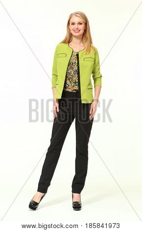 blond business woman in summer casual light green jacket black trousers high heeled shoes full body portrait isolated on white