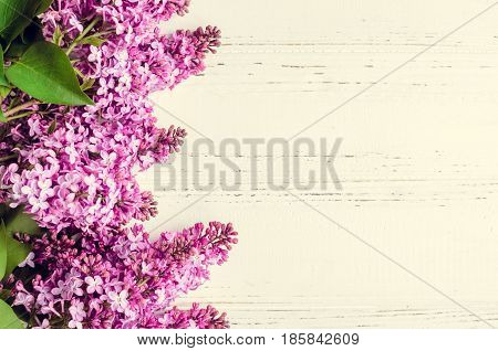 Beautiful spring flowers lilac on white wooden vintage board with place for text. Syringa vulgaris. Happy Mothers Day greetings card. Top view. Copy space.