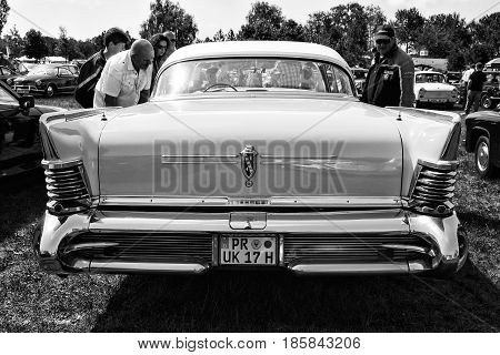 PAAREN IM GLIEN GERMANY - MAY 19: Personal luxury car Buick Series 700 Limited Hardtop Sedan (1958) black and white rear view The oldtimer show in MAFZ May 19 2013 in Paaren im Glien Germany