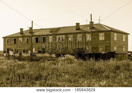 Abandoned rustic dwelling house with broken windows