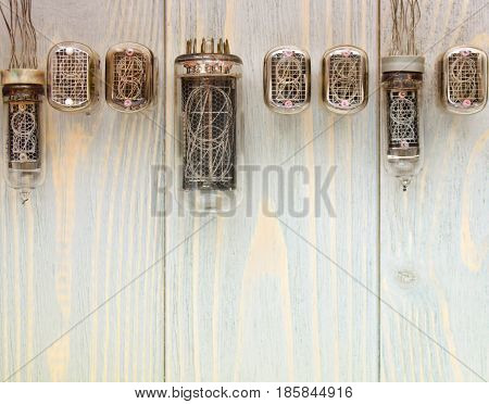 Top view of different nixie tubes on wooden planks.