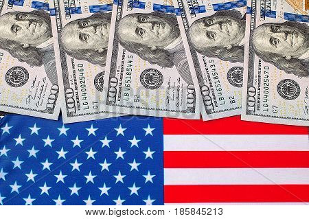 American dollars over the flag of the United States. financial concept