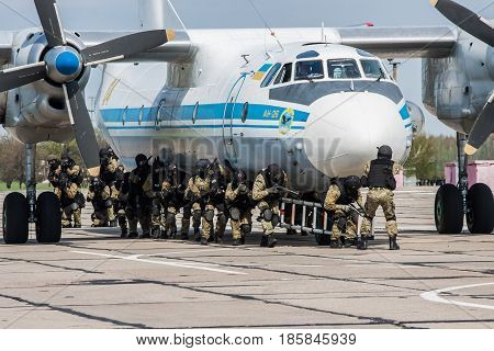 Kiev Region Ukraine - April 24 2012: Special counter-terrorist forces train to assault the plane captured by the terrorists
