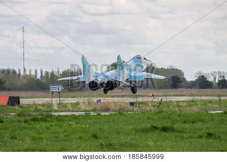 Kiev Region Ukraine - April 24 2012: Ukraine Air Force Aero MiG-29 jet fighter is taking off for another flight on cloudy day