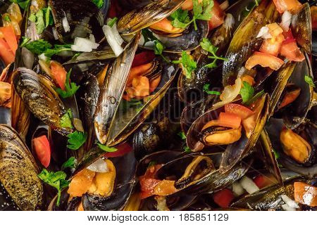 A closeup of marinara mussels, shot from above