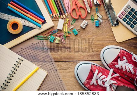 School supplie placed on a wood background concept ready for school.