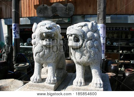 Jinju, South Korea - February 16, 2011 - Statue of Buddhist lions on the street of antiques  in February 16, 2011, Jinju, South Korea.