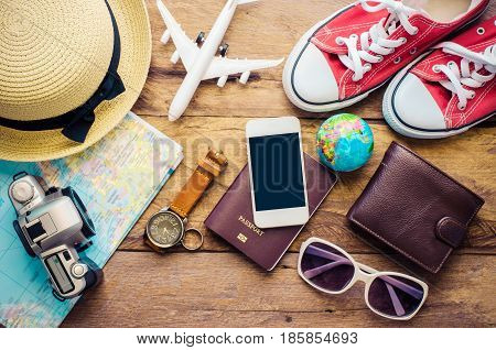 Travel accessories and costume on wooden floor