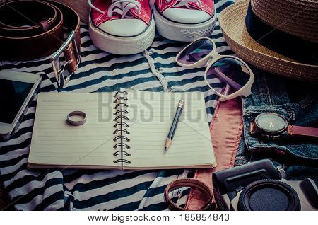 Travel accessories and costume on wooden floor - planing for travel