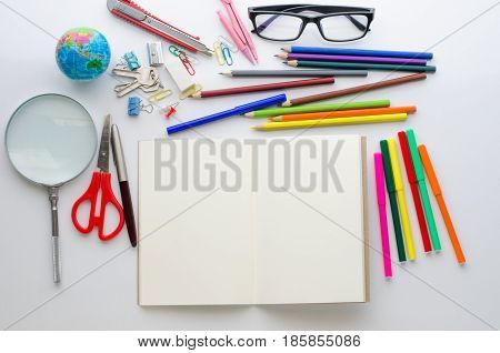 School supplies placed on a white background concept ready for school.