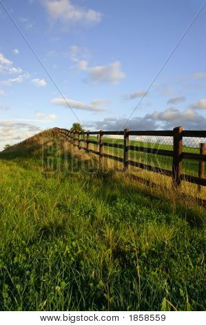 Rustic Fence In Lush Country Setting