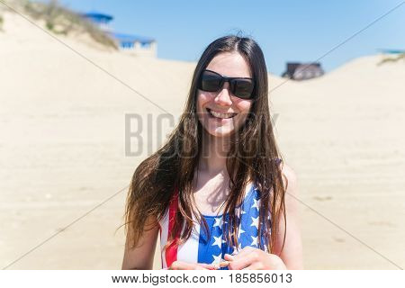 Close-up portrait of sensual girl on beach in swimsuit USA.