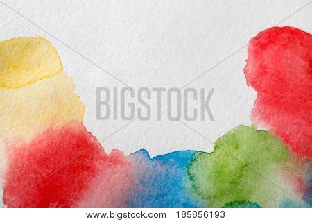 Abstract bright watercolor spots painted texture background. Red, violet and blue on white with copy space