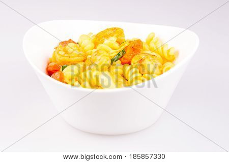 fusilli with curry shrimps zucchini and cherry tomato