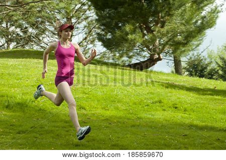 Mixed race woman running downhill