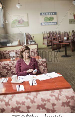 Caucasian woman working in restaurant