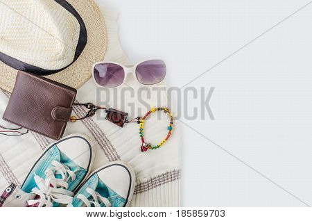Travel accessories costume Wallet watch shoes hat on a white background along for the trip.