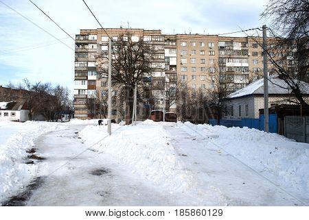 House high-rise white brick winter time snow