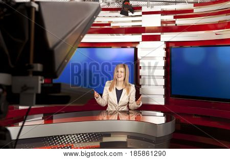A television anchorwoman at studio during live broadcasting