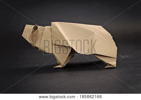 Brown Grizzly bear origami with black background