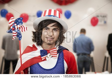 Hispanic voter in stars and stripes at polling place
