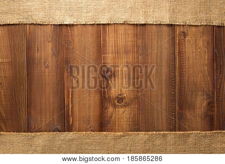 sack burlap hessian at wooden  plank background
